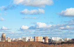Blue sky with white clouds over city in autumn day Royalty Free Stock Image