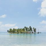 Blue Sky and White Clouds over Island Surrounded by Ocean Stock Image