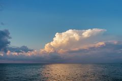 Blue sky with white clouds. Over sea royalty free stock photos