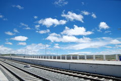 The blue sky and white clouds, railway. Tibet, a part of the train station on a very small scale Royalty Free Stock Photos