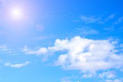 Blue sky with white clouds. rain clouds and sunshine on sunny summer or spring day Stock Image