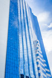 Blue sky and white clouds reflection on high building Stock Images