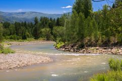Blue Sky, White Clouds, River Splashing, Flowing Over Rocks. Sunny Summer Day. Ivanovskiy Khrebet Ridge, Altai Mountains, Kazakhst. An. Tilt-Shift Artistic stock photos