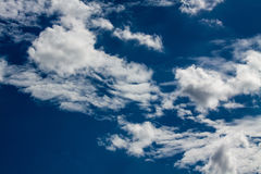 Blue sky with white clouds series 07. One of the images in a photo series depicting the grandeur of various cloud formations in the sky Royalty Free Stock Image
