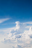 Blue Sky and White Clouds. Soft clouds and blue skies ahead. Image has a vertical orientation and was photographed from an airplane at 30,000 feet Royalty Free Stock Photography