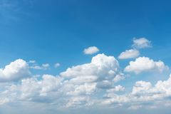 Blue sky and white clouds with space for text. Fresh and pure nature. Travel and summer vacation background Royalty Free Stock Photo