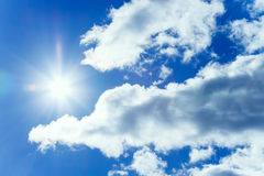 The blue sky with white clouds and the sun Royalty Free Stock Photography
