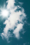 Blue sky with white clouds and sun. Blue sky with white clouds and bright sun Stock Image
