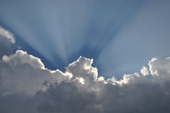 Blue sky and white clouds with sun rays Stock Photo