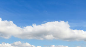 Blue sky white clouds with the sun Stock Image