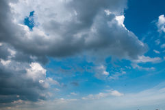 Blue sky with white clouds on sunset. Many little white clouds creating a tranquil weather pattern on the blue background. ใ royalty free stock photography