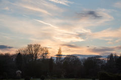 Blue sky white clouds at sunset. Silhouette , UK stock photos