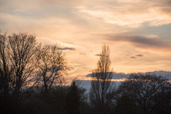 Blue sky white clouds at sunset. Silhouette , UK royalty free stock photography