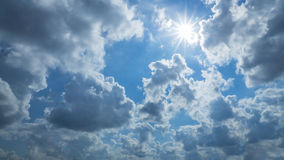 Blue sky with white clouds. And sunshine Stock Photo
