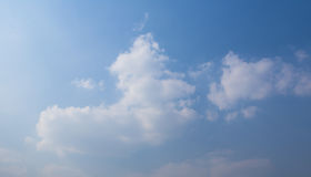 Blue sky white clouds and sunshine.  Royalty Free Stock Photo