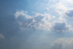 Blue sky and white clouds and sunshine.  Royalty Free Stock Image