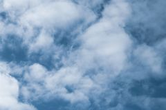 Blue sky with white clouds. Texture of cloudscape. Grey sky background with clouds. Dramatic scene.  royalty free stock photography