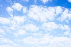 Blue sky with white clouds under sunshine Stock Photo