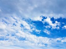 Blue sky with white clouds vivid color cloudscape. Light cloudy atmostphere Stock Image