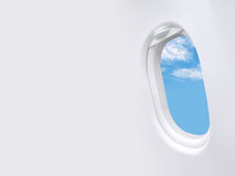 Blue sky white clouds in window plane frame and blank space template Royalty Free Stock Image