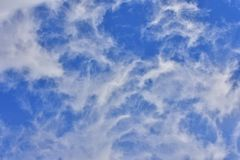 Blue Sky White Clouds Windy. Interesting blue sky with white clouds. In very windy day in mountains Royalty Free Stock Photo