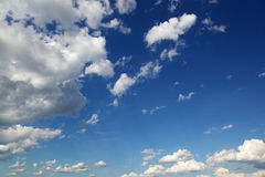 Blue sky with white cumulus clouds Stock Image