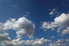 Blue sky with white cumulus clouds Stock Photos