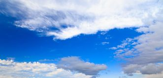 Blue sky with white cumulus clouds. Abstract natural background. Perfect summer day in the countryside stock images