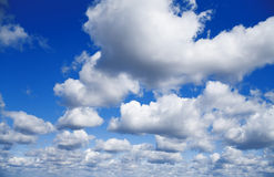 Blue sky with white cumulus clouds Royalty Free Stock Photo