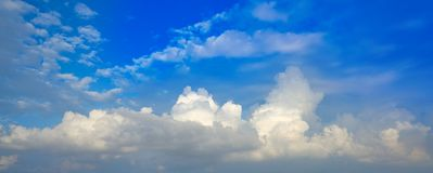 Blue sky white cumulus clouds. Background Royalty Free Stock Photo