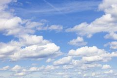 Background of Blue Sky with White Cumulus Clouds. Royalty Free Stock Photography