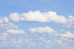 Background of Blue Sky with White Cumulus Clouds. Royalty Free Stock Image