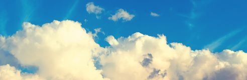 Blue sky with white cumulus clouds. Panoramic natural background stock images