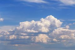 Blue sky with white cumulus fluffy clouds background texture. Bright blue sky with white cumulus fluffy clouds background texture royalty free stock image