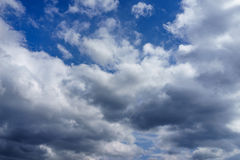 Blue sky with white and dark clouds Royalty Free Stock Image