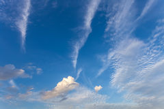 Blue sky with white fluffy clouds Stock Image
