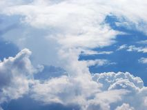 blue sky with white fluffy clouds royalty free stock photography