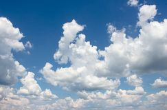 Blue sky with white fluffy clouds on a sunny day, cumulus, cloudscape background. Texture stock images