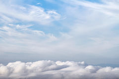 Blue sky with white fluffy clouds on winter Royalty Free Stock Image