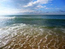 Light waves of blue sea and blue sky. stock image