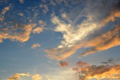 Blue sky with white and orange clouds in evening. Stock Photography