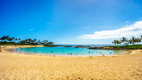Blue sky and and white sand at Ko Olina Lagoon 3, named Nai`a Lagoon. At the resort community of Ko Olina on the West Coast of the Hawaiian island of Oahu stock image