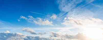 blue sky with white, soft clouds stock photography