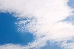 Blue sky with white spindrift clouds. Day, background royalty free stock photography