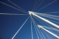 Blue sky and white strings of a bridge. Blue heavens and white stretchers of a bridge Royalty Free Stock Photos