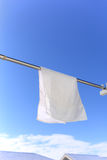Blue sky and white towel Royalty Free Stock Images