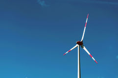 Blue sky with Wind turbines generating electricity. Wind power turbine generating electricity on blue sky stock photos