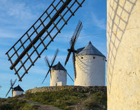 Blue sky and windmills in the background, Consuegra Stock Photo