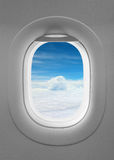 Blue sky window plane. White cabin royalty free stock photos