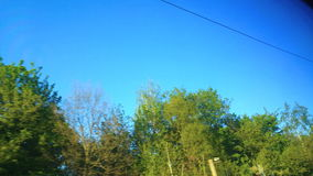 Blue sky from a window of train stock video footage
